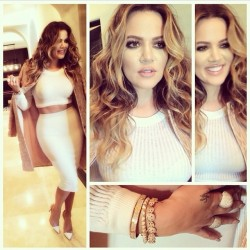 Khloe Kardashian vs. Kim Kardashian.  Wearing  similar outfits
