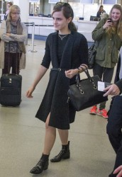 Emma Watson at Tegel Airport (Berlin, Germany 03/12)