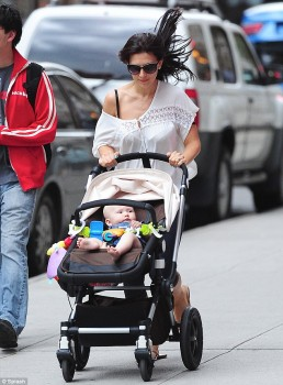 Hilaria Baldwin jets down the street with her infant daughter Carmen... and nearly loses her blouse mid-stride x 3 lq