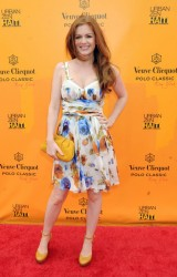 Isla Fisher on a windy day attends the Veuve Clicquot Polo Classic at Governor's Island 6/5/11