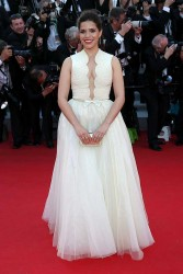 "America Ferrera in white dress attends the ""How To Train Your Dragon 2"" premiere during the 67th Annual Cannes Film Festival 5/16/14"