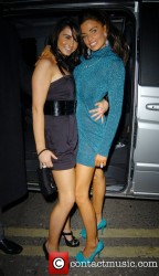 Katie Price flashes her underwear and kisses her sister outside the Movida nightclub  11/29/07