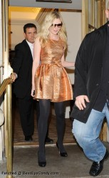Kirsten Dunst in orange dress and pantyhose at the Rodarte Spring 2010 fashion show