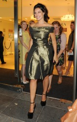 Kelly Brook in metallic dress attending the opening of the Pandora Oxford Street Store 9/5/13