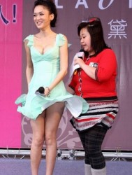 Joe Chen amazing cleavage and in a short dress at a windy unknown event