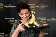 Juliette Binoche poses during a photocall at the 67th Locarno FF August 15-2014 x91