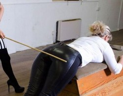 Spank in leather pants