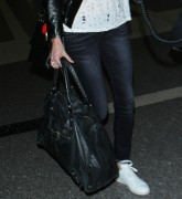 Charlize Theron catches flight out of LAX Airport on March 13-2015 x123
